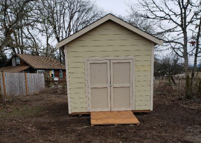 Small shed in country backyard