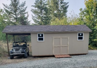 Storage shed with carport